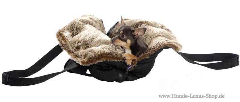 Eine potable Tasche für den Hund. geignet für kleine Hunde und Welpen. ERgibt aufgeklappt einen Schlafplatz. Luxus für unterwegs.